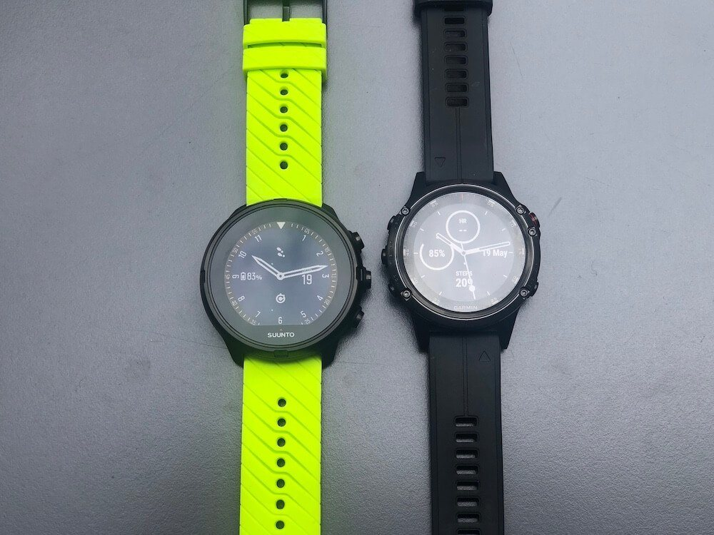 Suunto 9 and Fenix 5 plus front